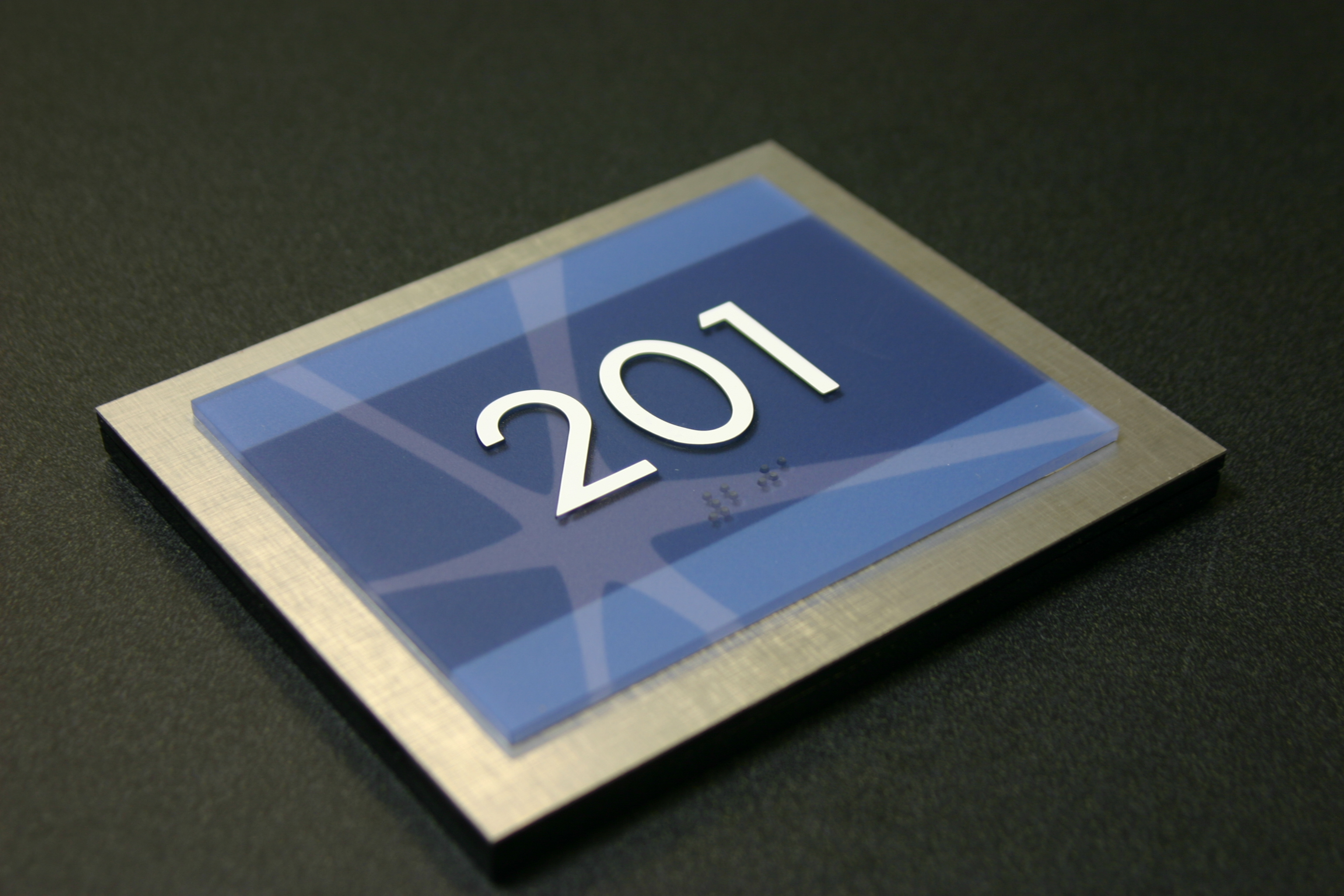 """Photopolymer sign with subsurface digitally printed graphics. .25"""" acrylic backplate with Chemetal laminate on face."""