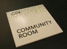 Photopolymer Community Room sign