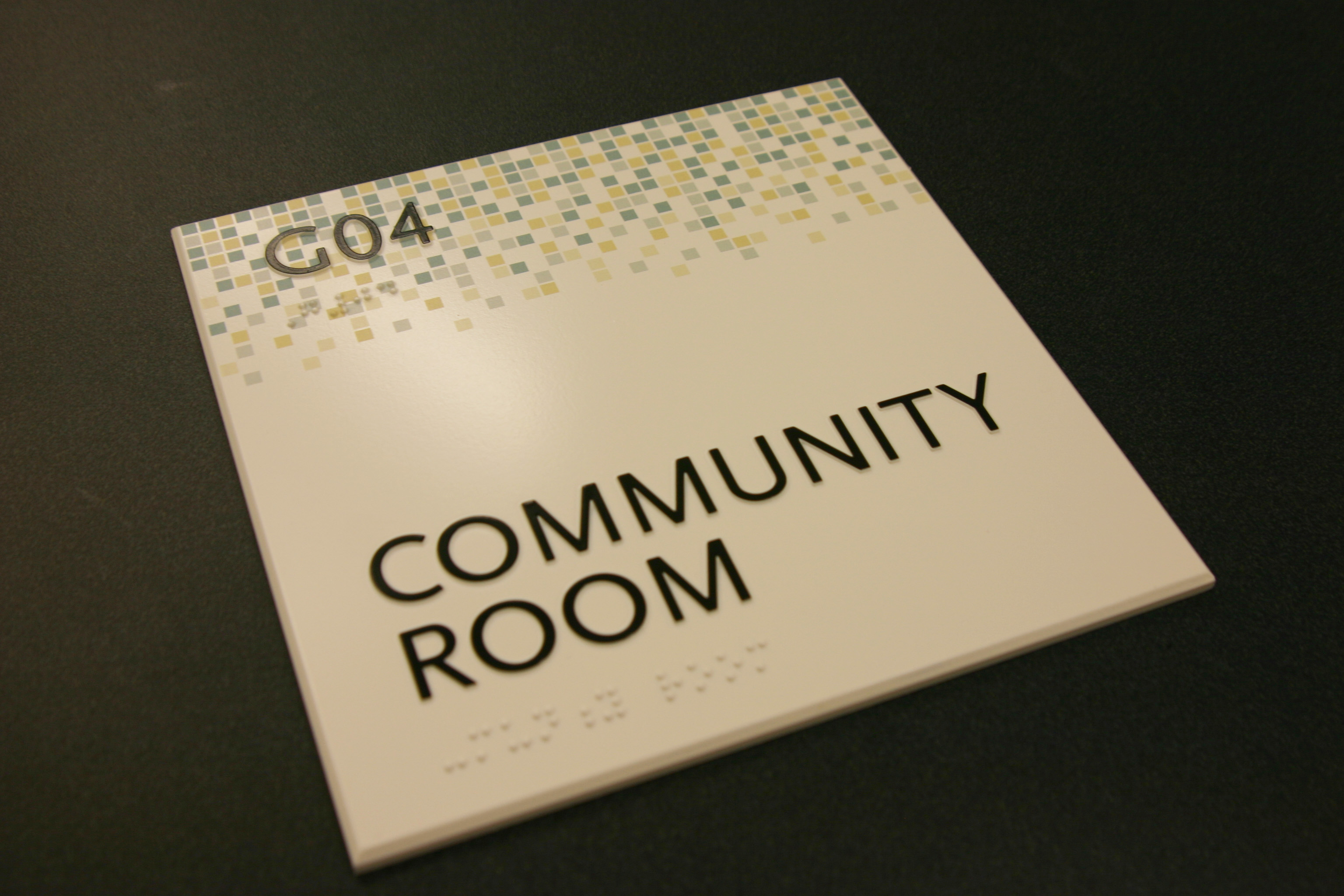 """125"""" photopolymer material with beveled edges. Surface applied paint and digitally printed graphic accent. Raised text and braille."""