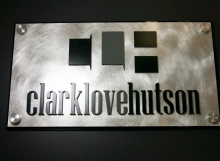 "Black acrylic baseplate with Chemetal laminate face, laser cut, surface painted .25"" acrylic letters applied to face of sign with decorative satin silver standoff caps."