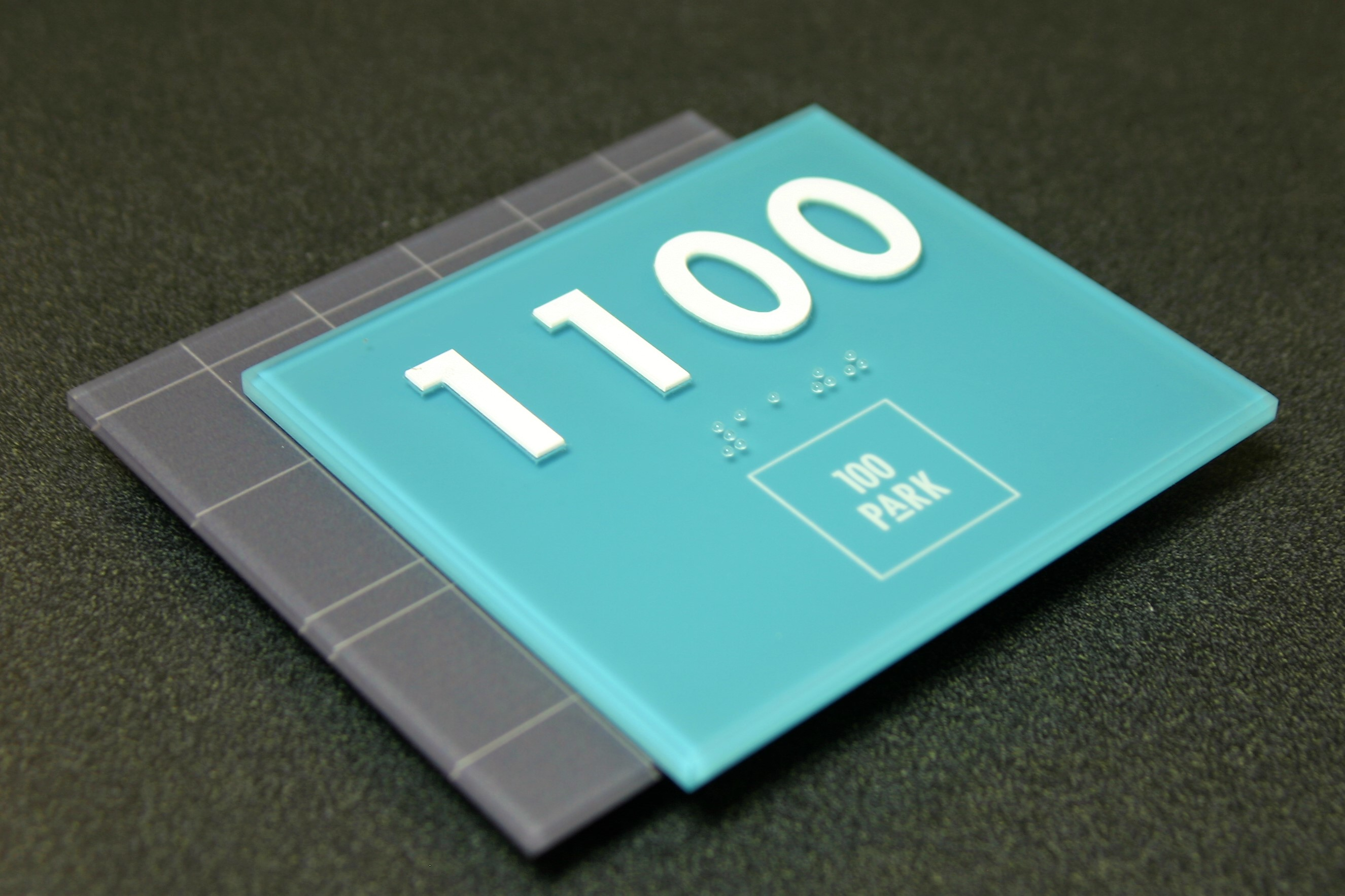 """.1875"""" non-glare acrylic faceplate with subsurface digitally printed graphics, .25"""" non-glare acrylic backplate with subsurface digitally printed graphics. Surface applied raised text and friction fit clear raster braille."""