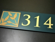 ".25"" surface painted photopolymer material with multiple color tipped integral graphics and text."