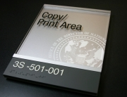 ".125"" photopolymer lower section with integral text and braille. Upper section .125"" clear acrylic with digitally printed text. Decorative aluminum bars that create sliding insert section at top. .125"" surface painted acrylic backplate with digitally printed logo."