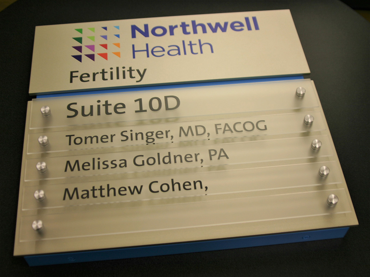 """Fabricated mounting frame constructed of 1"""" x 1"""" aluminum angle, .25"""" thick acrylic faceplate with digitally printed surface applied graphics and paint. Removable non-glare acrylic name slats with vinyl text and aluminum standoff hardware."""