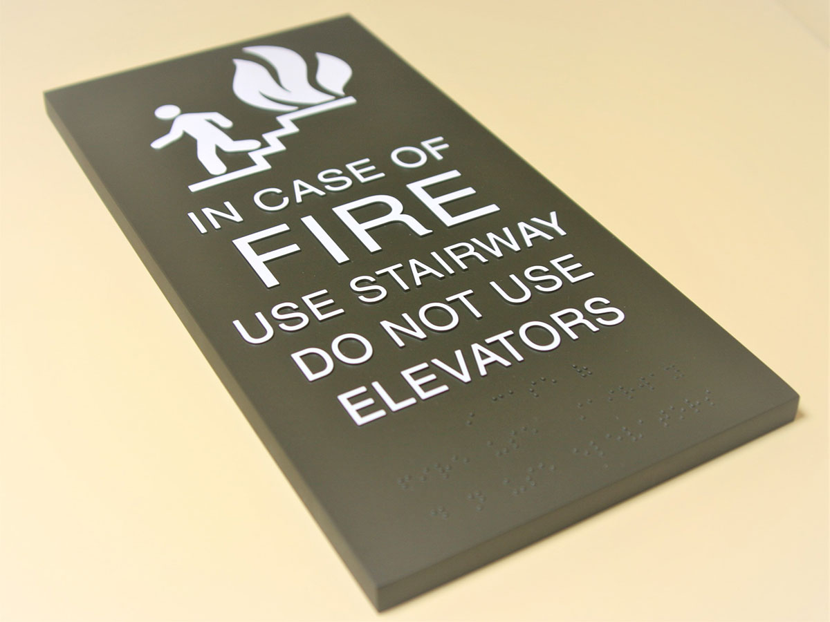 """.5"""" compression molded acrylic with surface applied paint, molded text (ink tipped) & braille."""