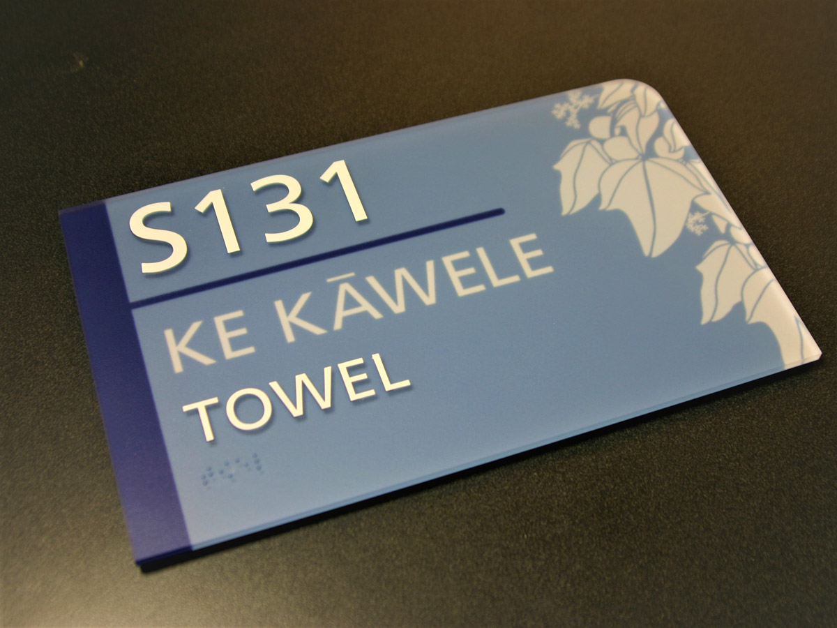 """.125"""" compression molded acrylic with subsurface applied paint, graphic and text. Integral molded raised text (ink tipped) & braille."""