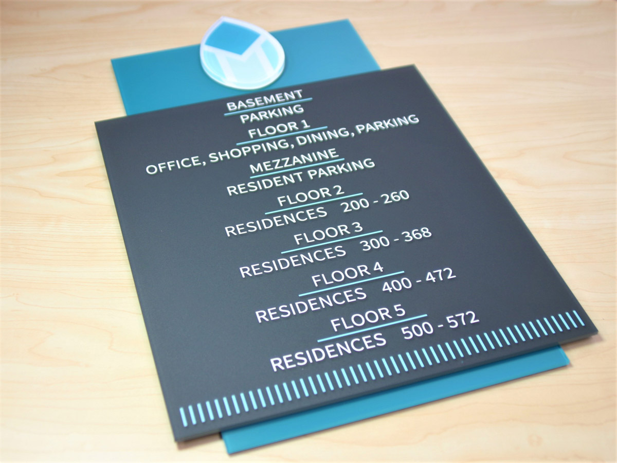"1/8"" thick subsurface painted non-glare acrylic backplate. Subsurface painted 1/8"" thick acrylic faceplate with digitally printed surface applied text and graphic. Accent at top of sign is laser cut ¼"" thick acrylic with digitally printed subsurface graphic."