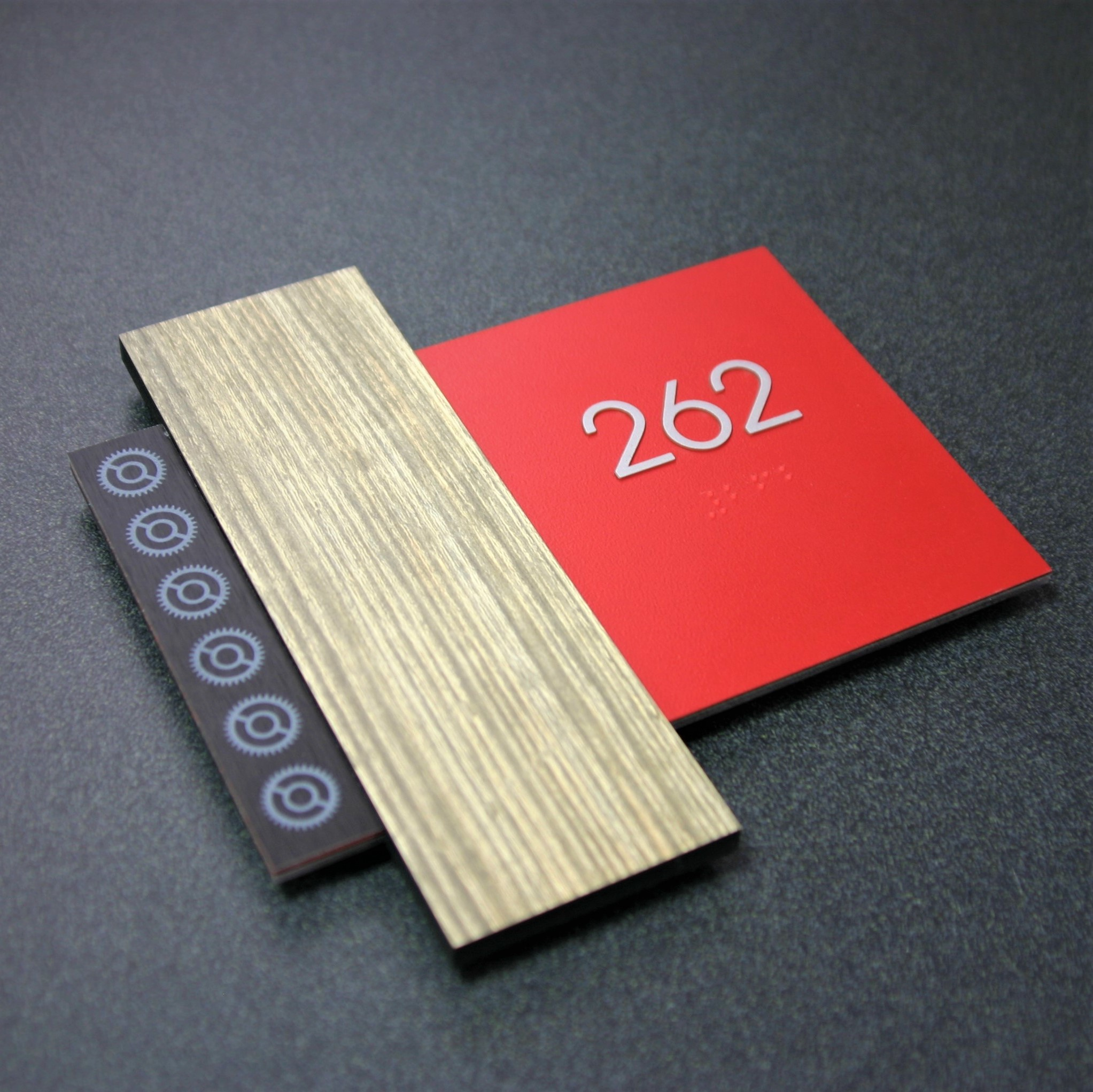 """Accent bar is Wilson Art laminate applied to 1/4"""" acrylic material. Faceplate is 1/8"""" thick photopolymer material with Wilson Art laminate, screen ink tipped text and digitally printed graphics."""